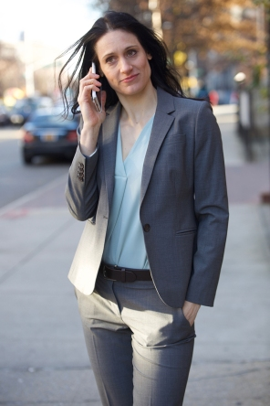 Fleece in suit with phone