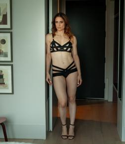 Standing shot black strappy lingerie